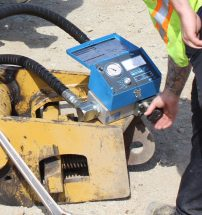excavator attachment setup flow meter